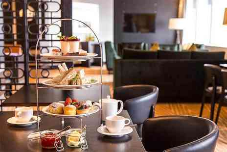 Hilton Canary Wharf - Afternoon tea for two with a bottle of bubbly to share - Save 61%