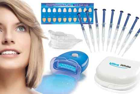 Groupon Goods Global GmbH - Ultra White Home Teeth Whitening Kit with 3, 9 or 15 Syringes - Save 67%