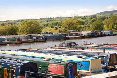 Reedley Marina - 60 minute Leeds and Liverpool canal cruise with afternoon tea and a glass of Prosecco each for two - Save 58%