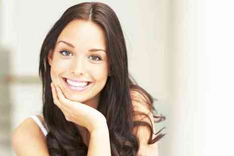Smileright Dental Clinic - Laser teeth whitening with a check up and two X rays - Save 0%