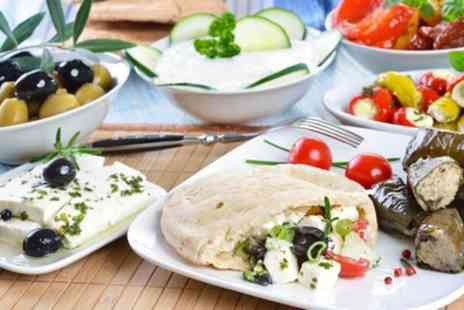 Georges Bar and Grill - Nine Dish Greek Meze with Glass of Wine for Two or Four - Save 48%