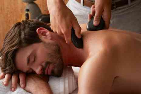 Hotep Holistic - Hot Stone Back, Neck and Shoulders Massage with Optional Facial - Save 53%