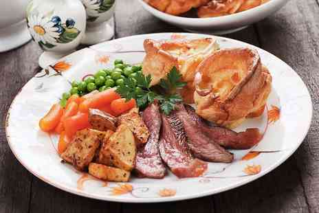 Ambrosia Caffe & Ristorante - Sunday roast with a glass of bubbly each for two - Save 50%