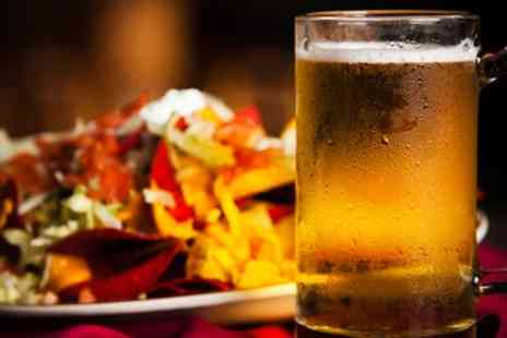 Brass Monkey - One portion of nachos and four bottles of beer - Save 45%