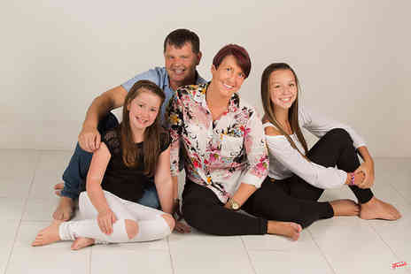 "The Click Group - Family photoshoot, one 8"" x 10"" print, two 5"" x 7"" prints, a £50 voucher towards any wall hanging and a £50 voucher towards any portfolio or album - Save 97%"