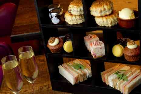 Hilton Garden Inn - Traditional Afternoon Tea with Optional Glass of Prosecco for Two or Four - Save 46%