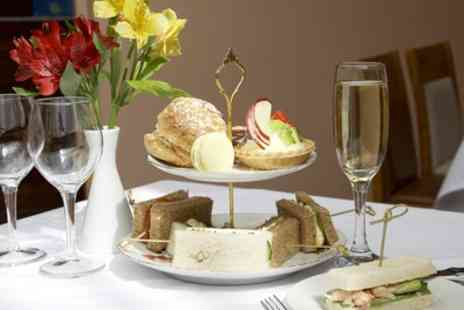 The George Hotel - Afternoon Tea with Prosecco for Two or Four - Save 42%