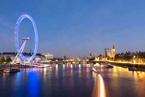 City Cruises - Thames night cruise for two people including a four course dinner, glass of bubbly, bottle of wine to share and dancing - Save 44%