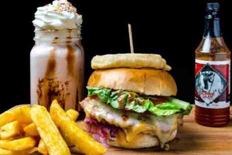 The Smoque Pit - Burger, Fries and Milkshake or Soft Drink for Up to Four - Save 51%