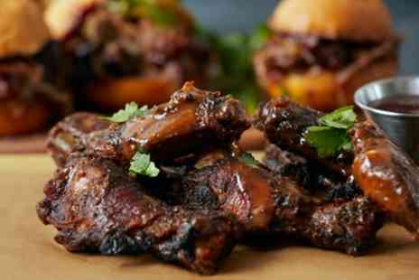 The Smoque Pit - 12 Wings to Share Between Pairs with Side and Drink Each for Two or Four - Save 44%