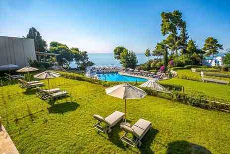 Book It Now Holidays - Seven night half board luxury Corfu beach break with one complimentary cocktail each and return flights - Save 63%