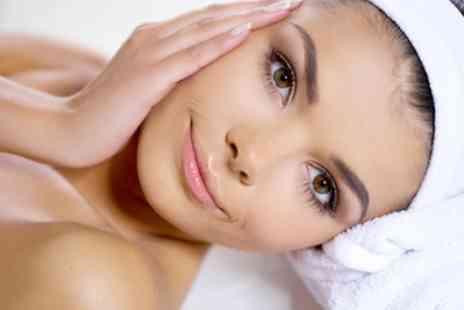 Dermal Essence - 40 Minute Dermaplaning Session or 60-Minute Chemical Peel Facial with Led Therapy - Save 24%