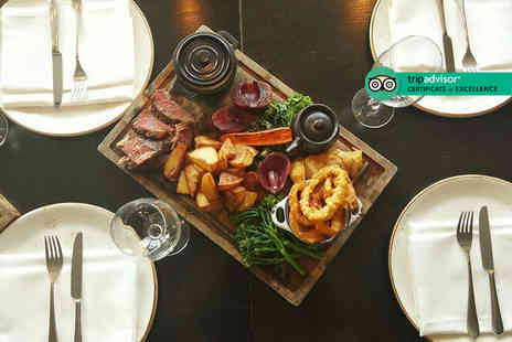 Hilton Canary Wharf - Roasting board dinner for two people with a bottle of wine to share - Save 61%