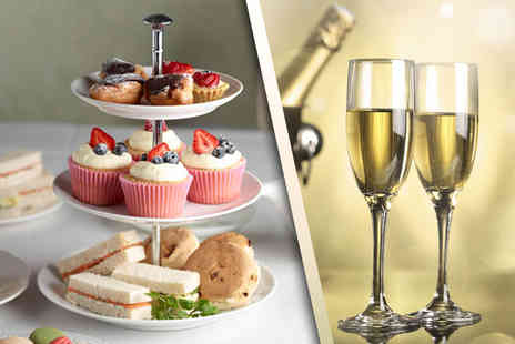 Risley Hall Hotel - Afternoon tea for two or four, with a glass of Prosecco - Save 47%