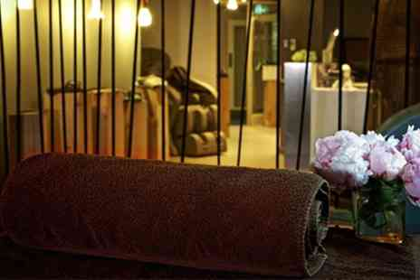 Spa at the Hilton Park Lane - Choice of Massage with Hands Mask with Optional Facial and glass of bubbly - Save 42%