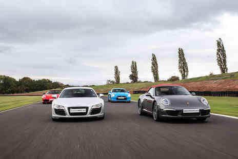 Virgin Experience Days - Buckle up for the ultimate driving experience with this Four Supercar Thrill - Save 49%