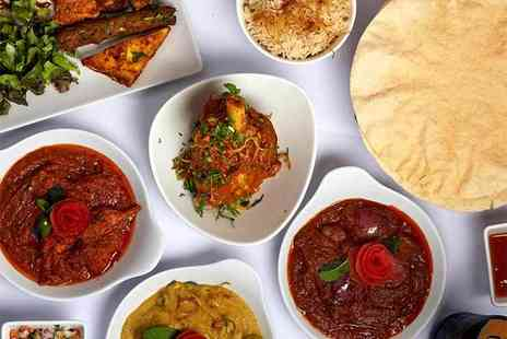 India India - Two course meal with rice and a naan to share and a glass of wine each - Save 32%