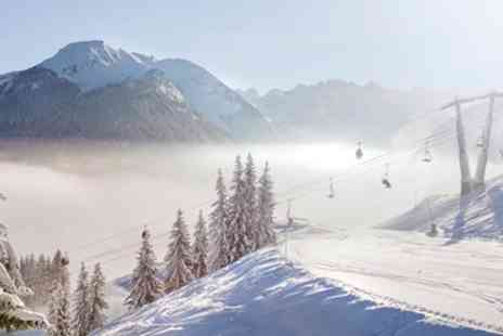 Alpine Elements - Half term Morzine ski holiday With flights, meals and hot tub - Save 0%