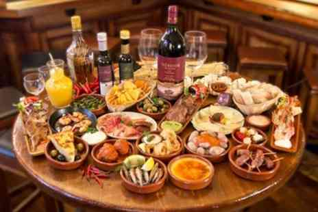 El Puerto - 6 or 12 Spanish Tapas with a Bottle of Wine for Two or Four - Save 54%