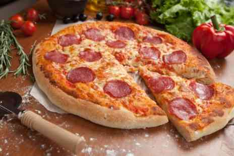 Royal Coast Cafe & Restaurant - Choice of Pizza with Cold Soft Drink for Two or Four - Save 29%