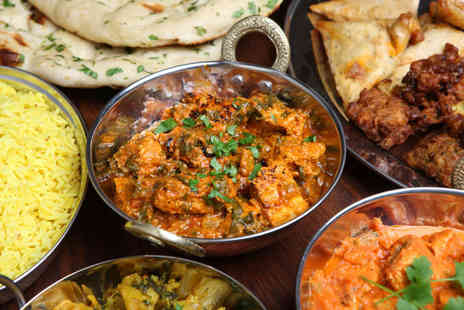 India Gate - £25 Voucher for two people to spend on food and drink with poppadoms and dips on arrival - Save 48%