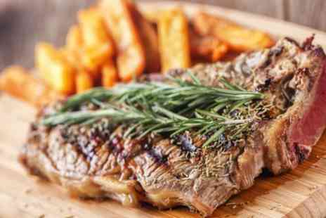 The Roundabout Hotel - Sirloin Steak Meal with Glass of Wine for Two or Four - Save 38%