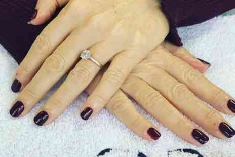 Indulge Tanning and Beauty - Shellac Manicure or Pedicure or Both - Save 40%