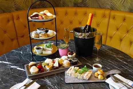 Clayton Hotel - Afternoon tea for two people with a bottle of Prosecco to share and free flowing tea - Save 0%