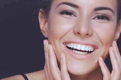 Sonria Dental Clinic - One Hour Laser Teeth Whitening Session - Save 73%