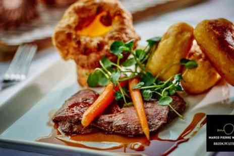 Marco Pierre White Steakhouse Bar & Grill - Two Course Sunday Roast with Wine for Two or Four - Save 37%