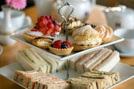 Village Tea Rooms - Afternoon tea for two with a hot chocolate each - Save 52%