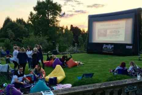 Crabwall Open Air Cinema - Ticket for one adult, one adult and one child, two adults or a family of four with a welcome drink from 21st June or 23rd August - Save 41%