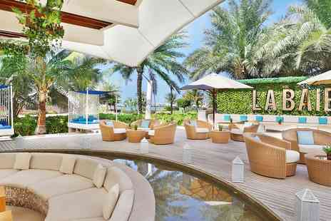 Value Added Travel - Family of 4 Luxury Ritz Carlton Dubai holiday with meals - Save 0%