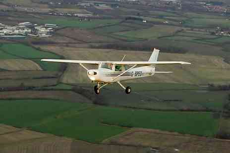 Take Flight Aviation - 30 minute Cessna Flying experience - Save 43%