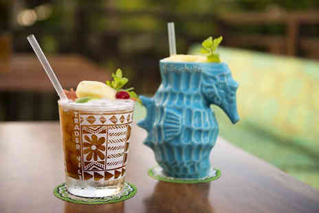 Trader Vics - Four cocktails between two people and two small plates to share with entertainment - Save 70%