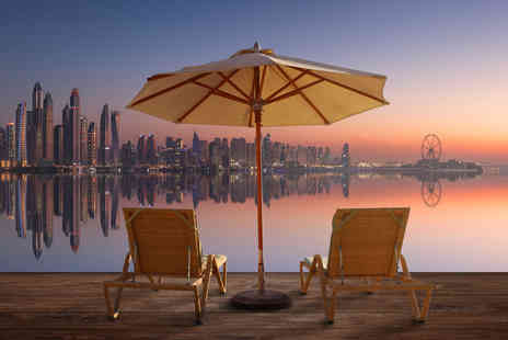 Super Escapes Travel - Four Star Three nights Dubai holiday aboard the QE2 with breakfast and return flights - Save 28%
