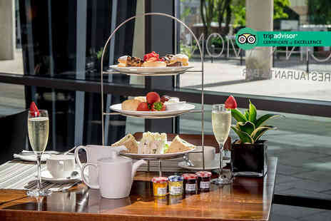 Hilton Canary Wharf - Afternoon tea for two people with a bottle of bubbly to share - Save 0%