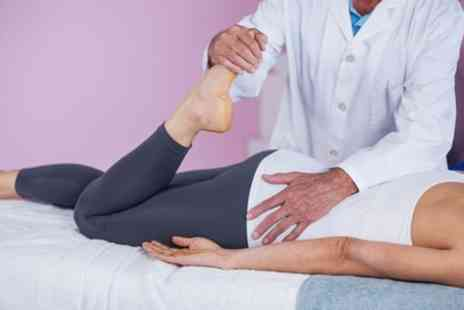 Emerald Chiropractic Care - Chiropractic Exam and Treatment with One or Two Follow Up Sessions - Save 73%