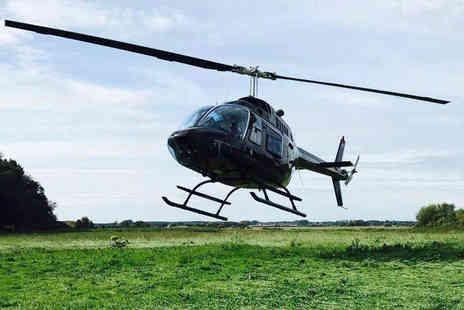 Adventure 001 - Six mile helicopter buzz flight for two people with chocolates and a glass of bubbly each - Save 50%