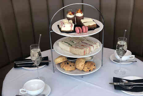 Marco Pierre White Steakhouse - Luxury afternoon tea for two people with a Bellini or glass of Prosecco each - Save 59%