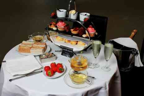 Number Twelve - Afternoon tea for two people with one hour of bottomless cocktails - Save 42%
