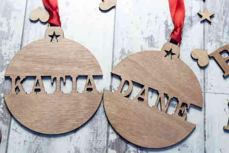 Personalised Gifts Market - Two personalised wooden Christmas tree decorations, for four, or for six - Save 83%