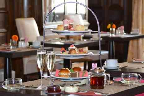 The Tower - Afternoon Tea with Optional Glass of Prosecco Each for Two or Four - Save 44%