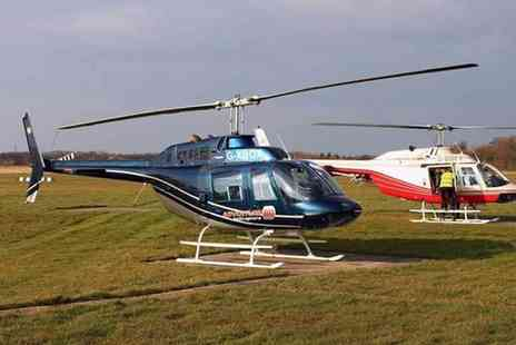 Adventure 001 - Winter skies helicopter tour for one person - Save 54%