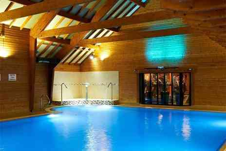 Bannatyne Spa - Spa package for two people with a choice of 3, 55 minute treatment bundle and £5 retail voucher each - Save 59%