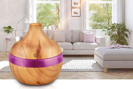 Impress Gadgets - Electric humidifier and oil diffuser with a bottle of essential oil - Save 89%