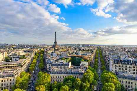 Travel Center - Four Star two nights Paris break with flights, breakfast, night tour and tickets to Moulin Rouge - Save 26%