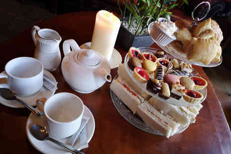 Drummonds Hotel - Afternoon tea for two people with a glass of Prosecco each - Save 60%